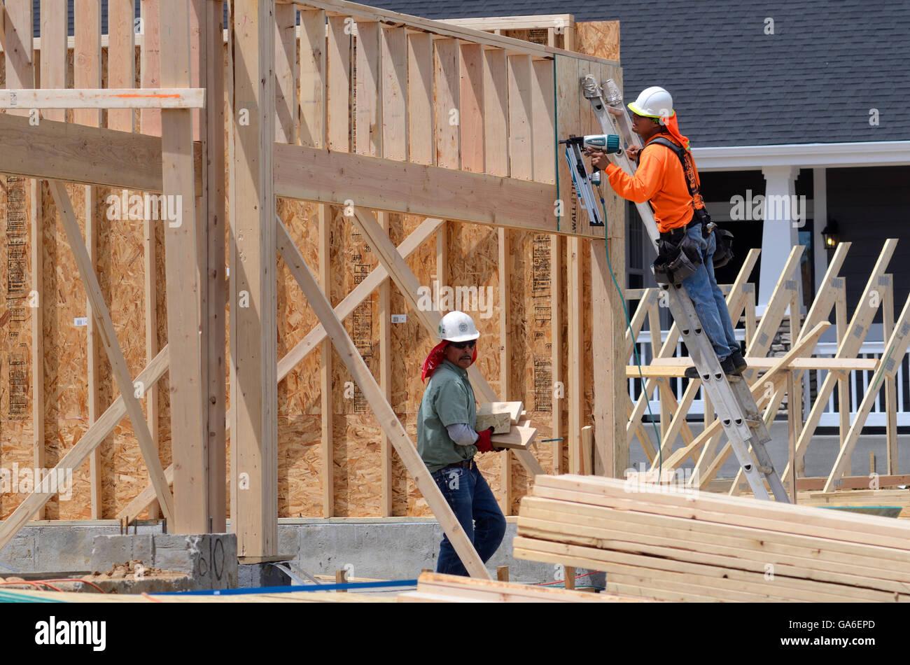 Carpenters work on framing in new subdivision in Superior Colorado ...