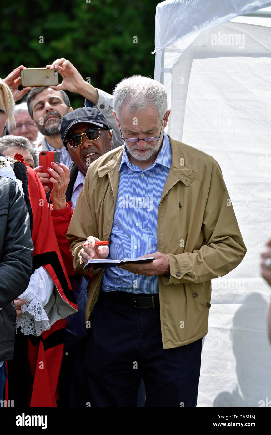 Jeremy Corbyn making notes at the - say no to hate crime rally, Highbury Fields, London Borough of Islington England - Stock Image