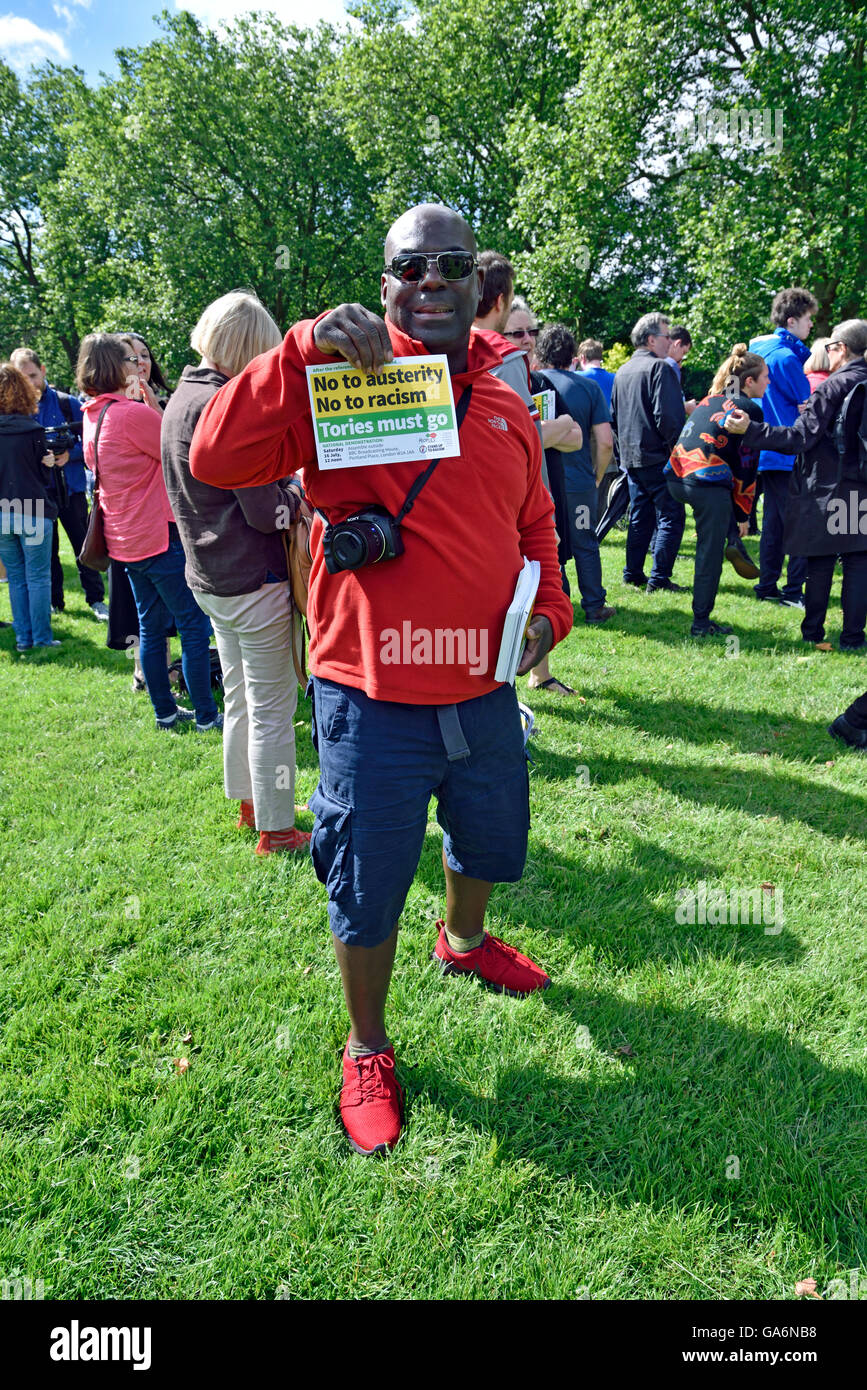 Man holding leaflet at the - say no to hate crime rally - on Highbury Fields, London Borough of Islington England - Stock Image