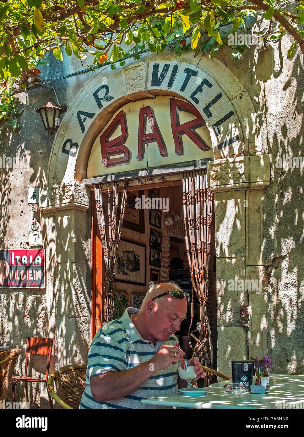 Bar Vitelli in the medieval village of Savoca, Sicily, the bar was used in the filming of the Godfather movie. - Stock Image