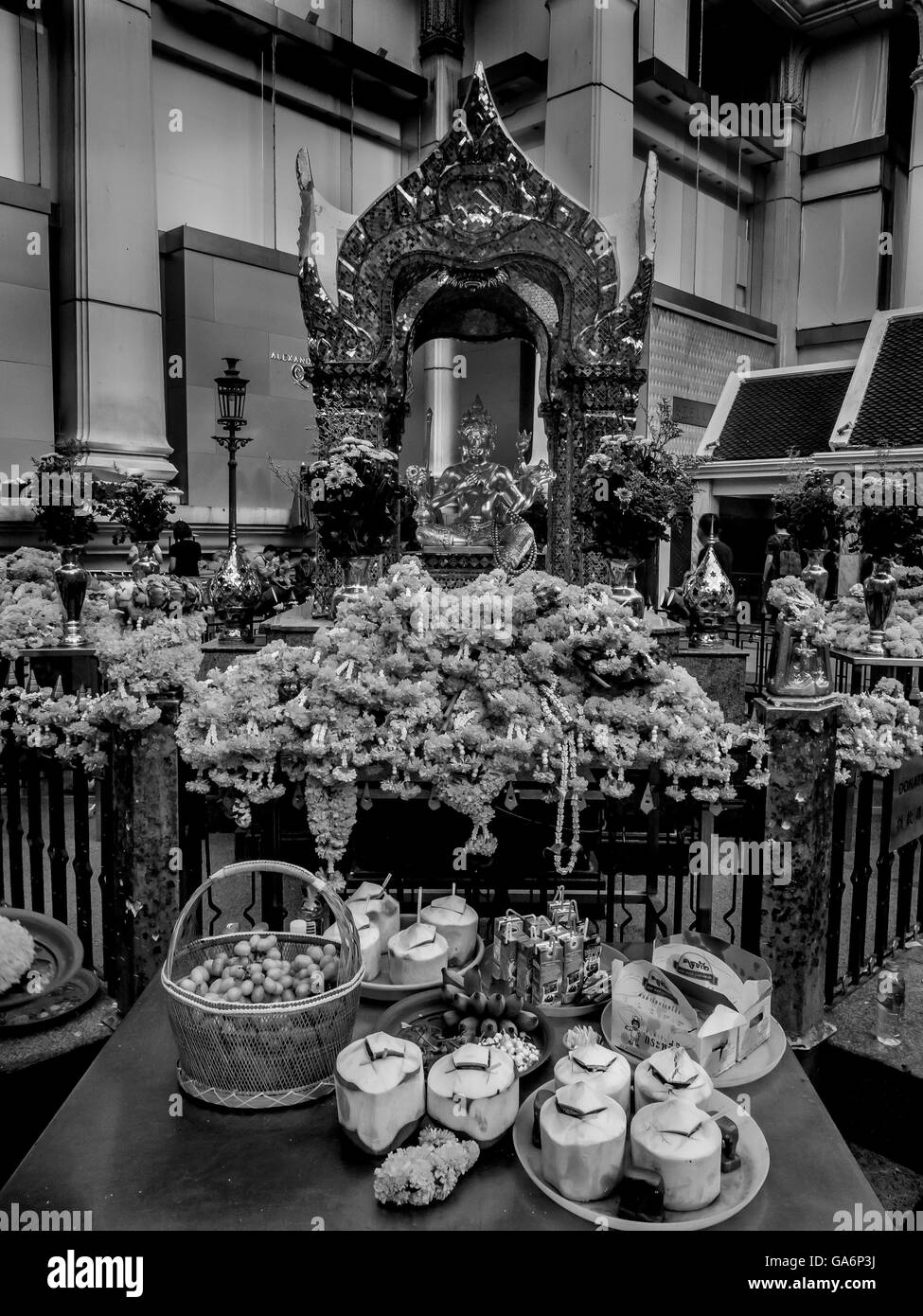 Erawan Shrine and offerings following terrorist bomb - Stock Image