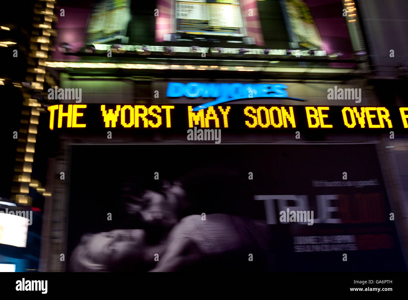 Dow Jones electronic news ticker on Times Square in New York 25 June 2009. Message reads 'the worst may soon - Stock Image