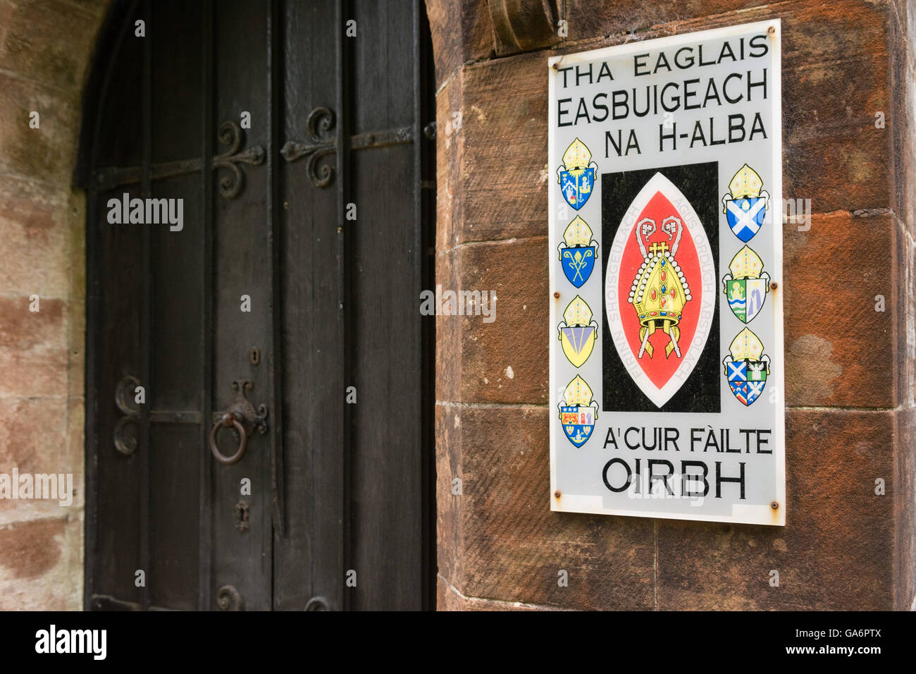 The Scottish Episcopal Church sign by the door of Inveraray bell tower in Argyll, Scotland - written in Scots Gaelic - Stock Image
