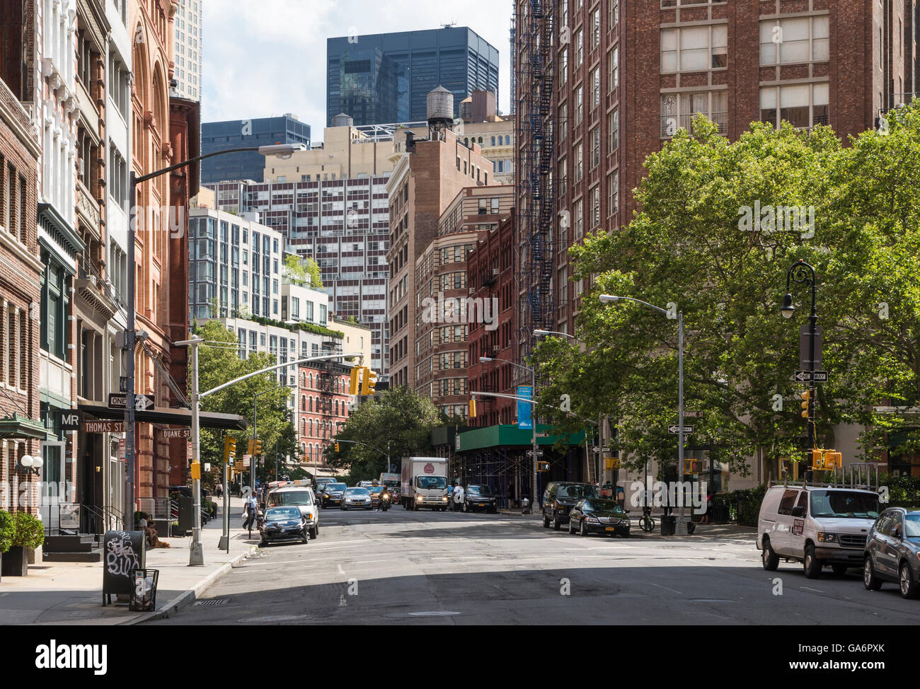 Street view along Hudson Street, Tribeca, with contrasting old and new buildings and skyscrapers with fire escapes Stock Photo