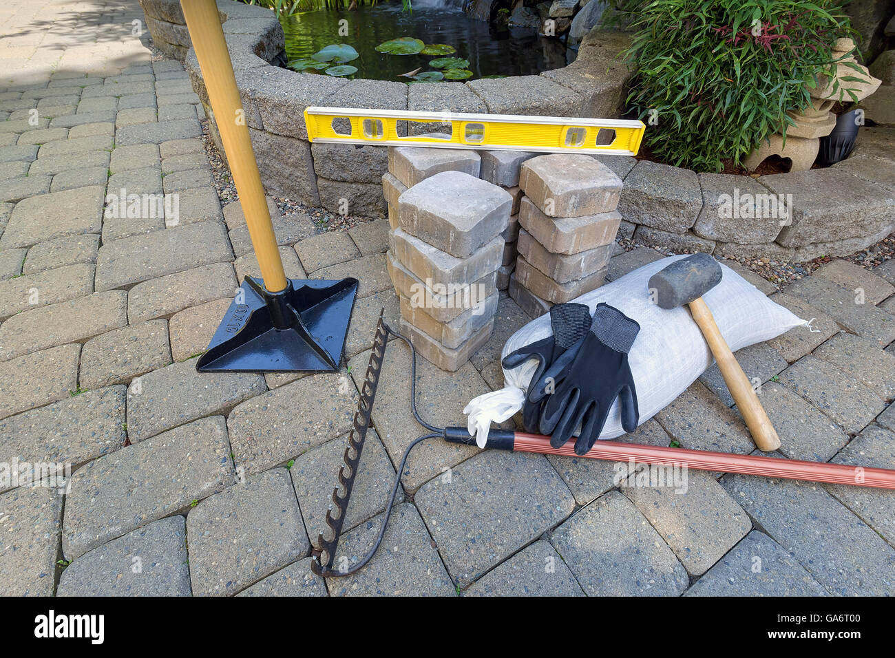 Stone Pavers for backyard patio pond hardscape with garden landscaping  tools gloves level rubber mallet sand gravel tamper - Stone Pavers For Backyard Patio Pond Hardscape With Garden Stock