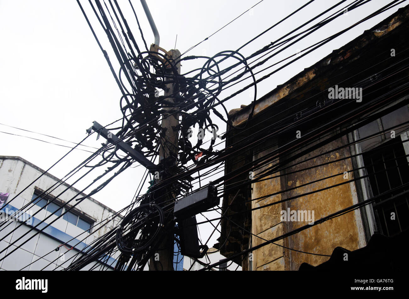 Many Wires Messy With Power Line Cables Transformers And Phone Wiring Lines On Old Electricity Pillar Or Utility Pole At Beside Road A