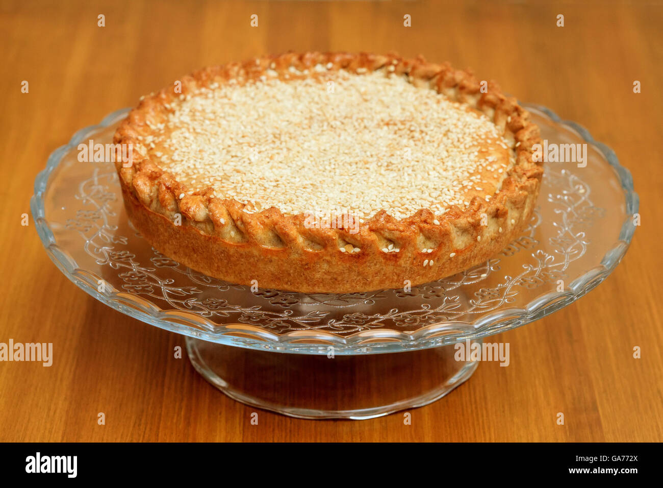 Cooked meat pie with sesame on a crystal bowl - Stock Image