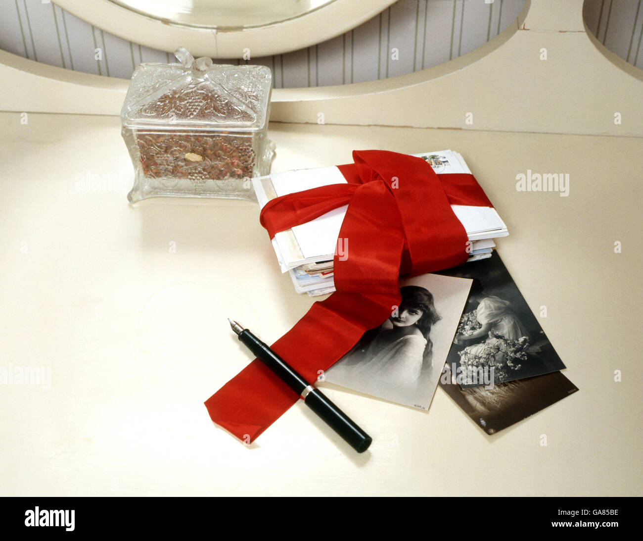 Love letters with red ribbon - Stock Image
