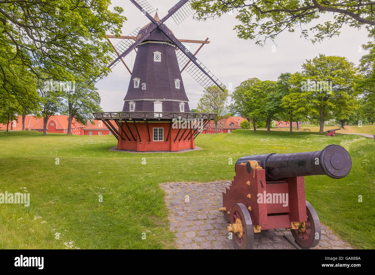 Windmill and Canon At The  Kastellet Fortress Copenhagen Denmark - Stock Image