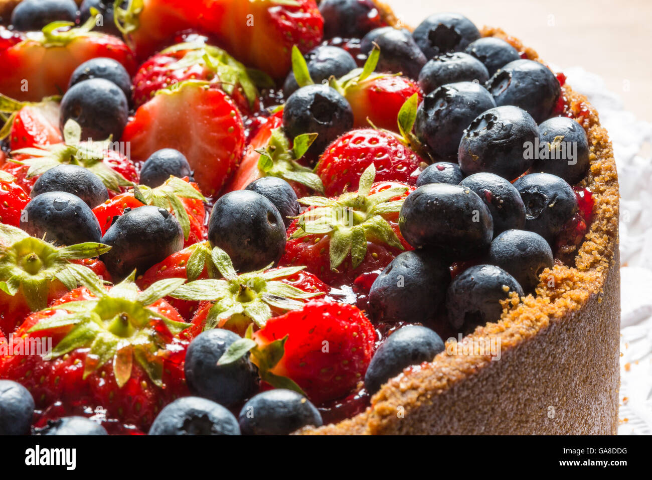 cheese cake with strawberries and blueberries - Stock Image