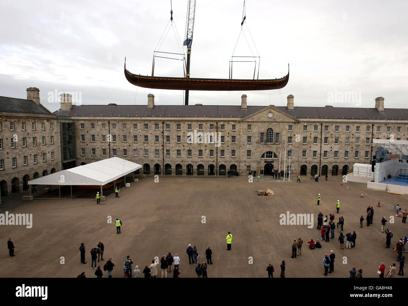 Viking ship lifted into museum. - Stock Image