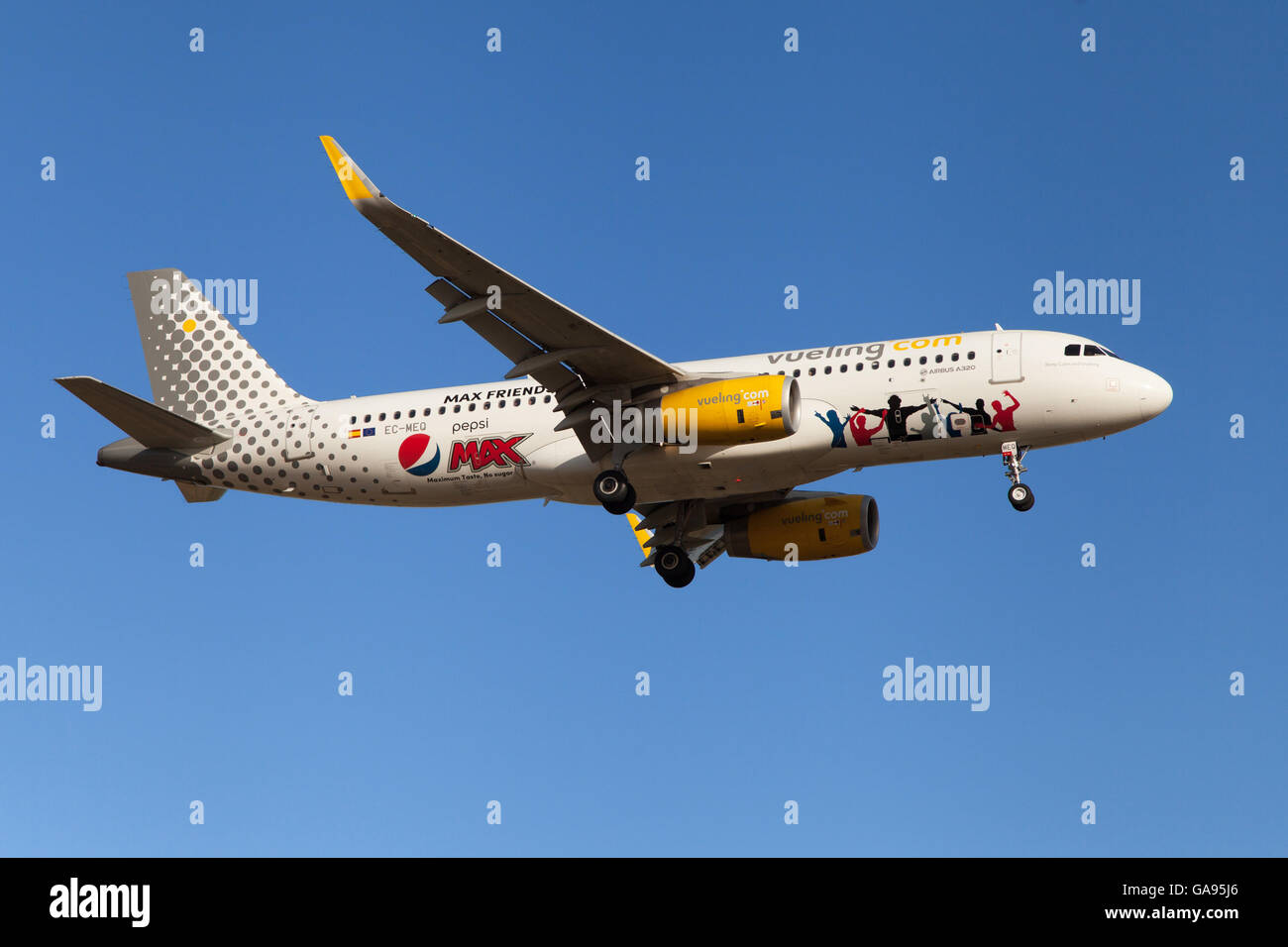 A Vueling Airbus A320-200 wearing Pepsi Max special livery approaching to El Prat Airport in Barcelona, Spain. - Stock Image