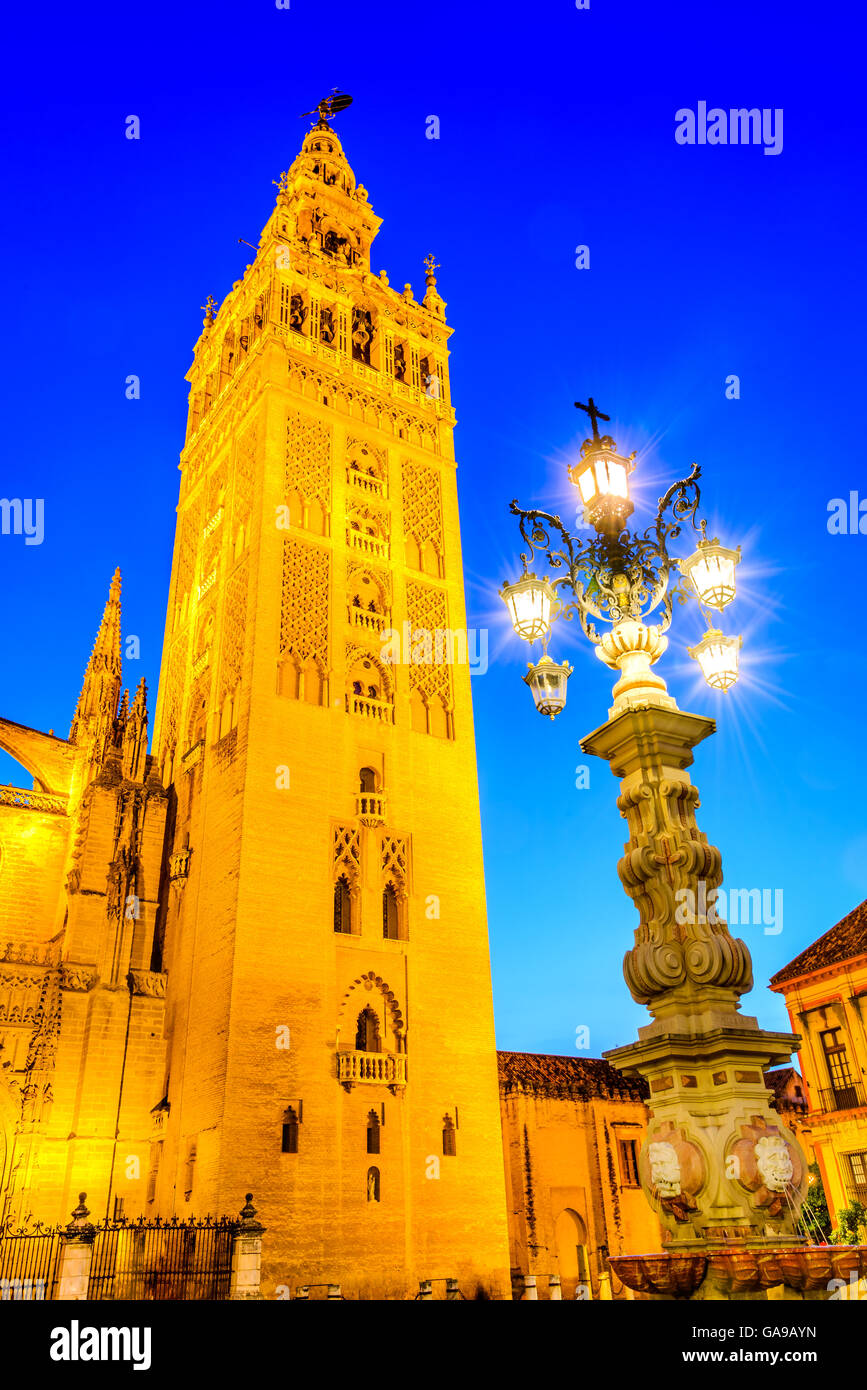 Seville, Andalusia, Spain. Cityscape twilight image with Santa Maria de la Sede Cathedral and Giralda - Stock Image