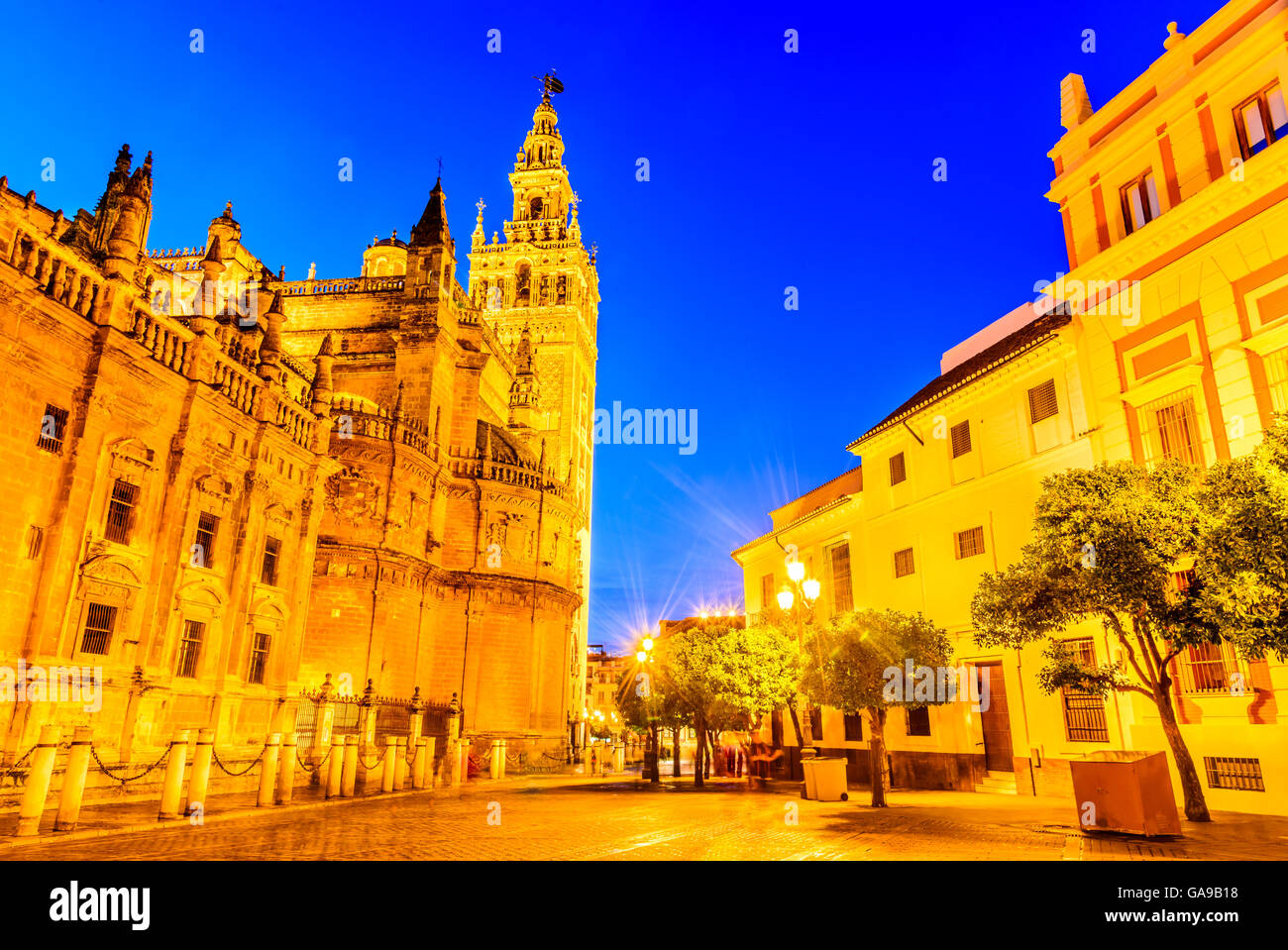 Seville, Andalusia, Spain. Cityscape twilight image with Santa Maria de la Sede Cathedral and Giralda. - Stock Image