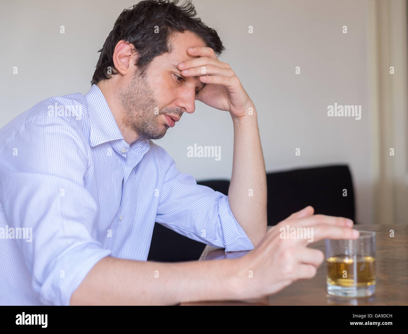 [Image: depressed-man-abusing-of-alcohol-trying-...GA9DCH.jpg]