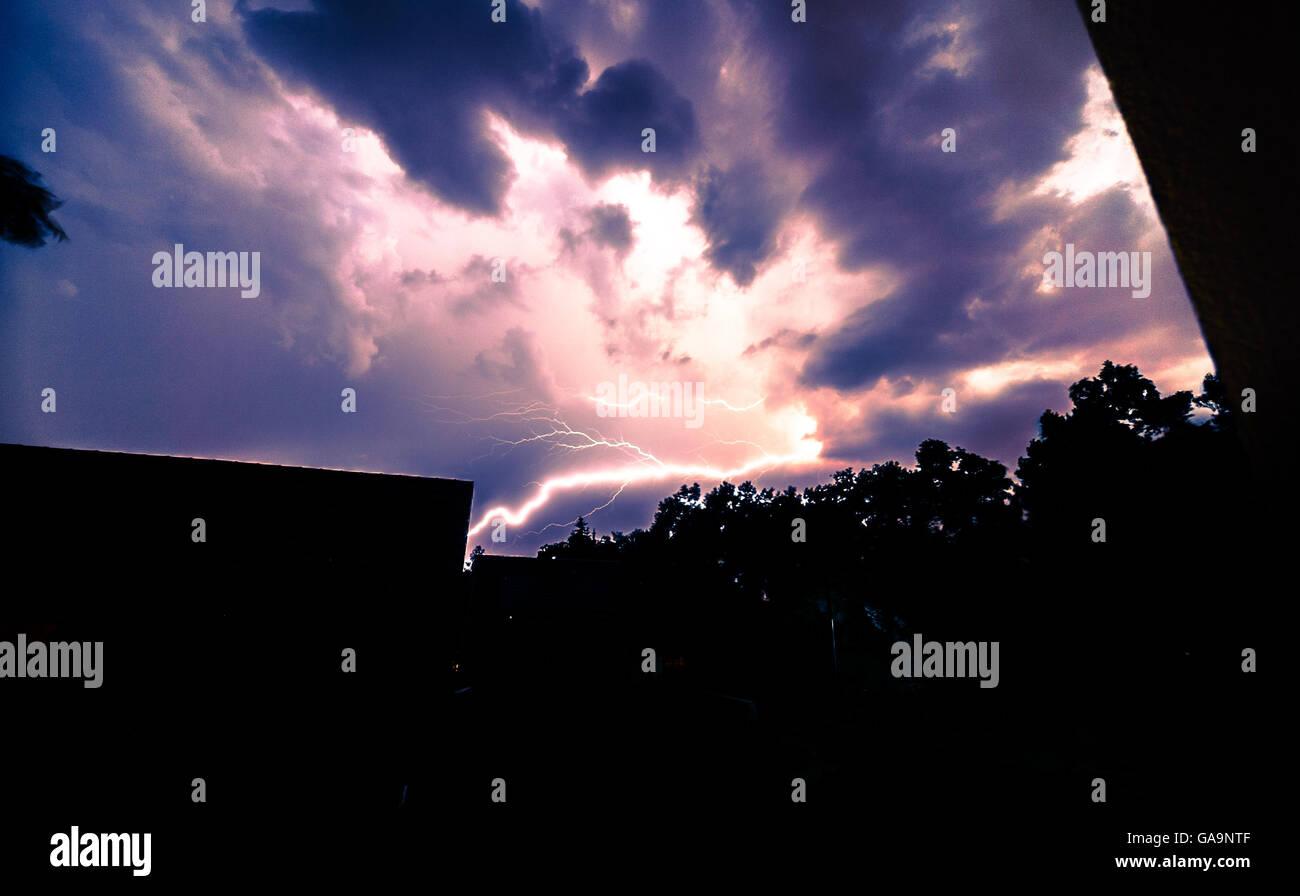Fork lightning striking down - Stock Image