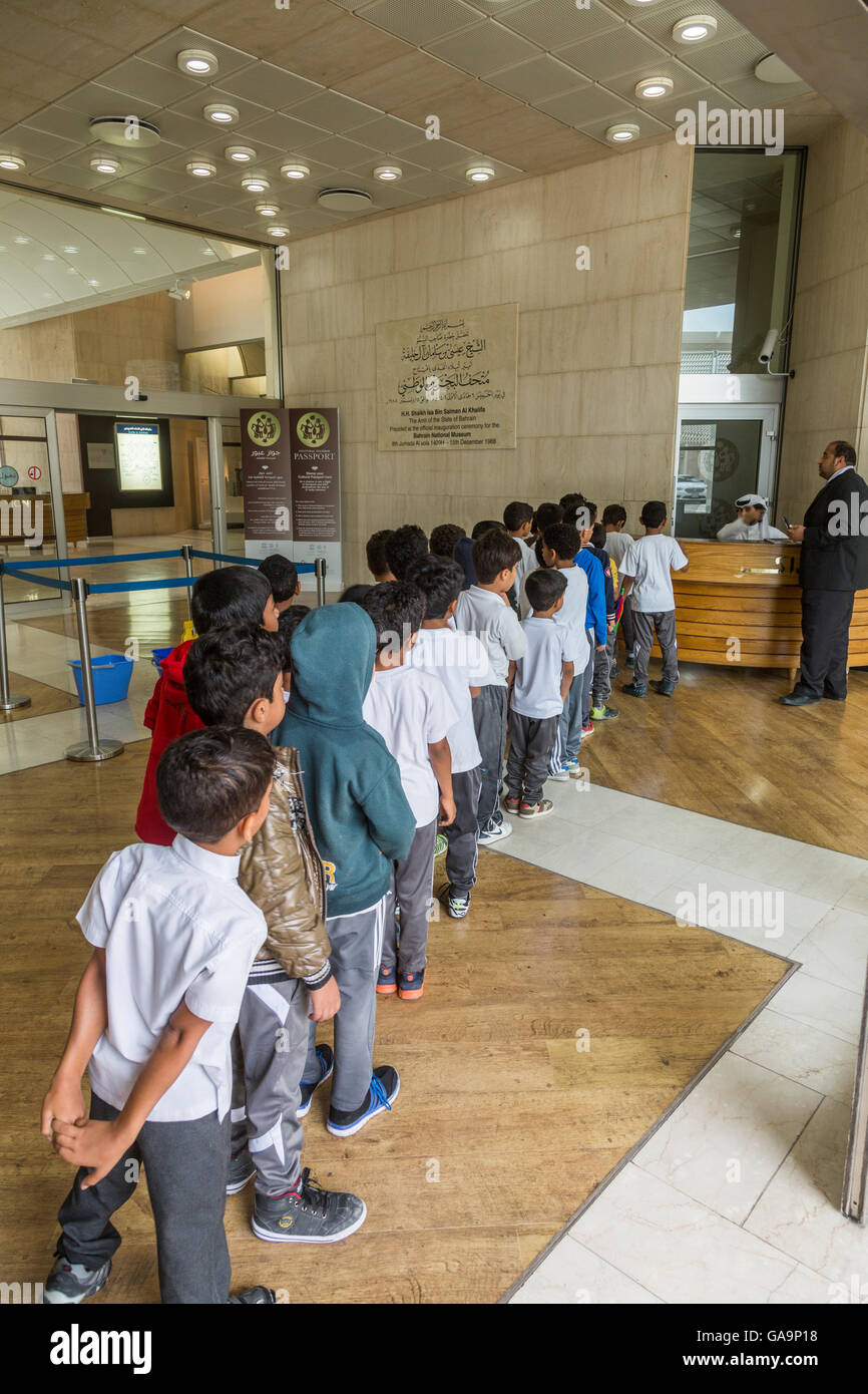 queue of schoolchildren at the Bahrain National Museum Stock Photo