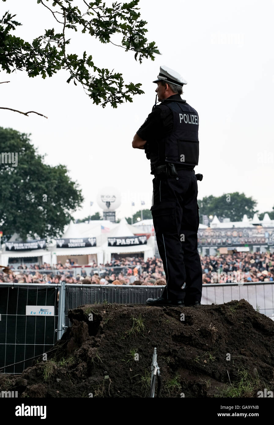 Policemen controlling the grounds of the Wacken Open Air festival in Wacken, Germany, 4 August 2016. 75,000 fans - Stock Image