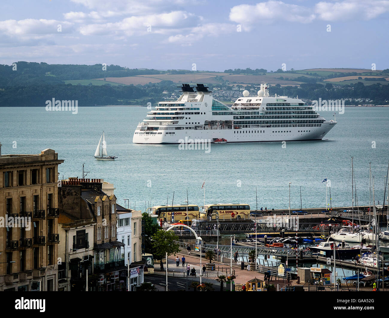 GB - DEVON: Torquay harbour, 5th August, 2016. MS Seabourn Quest (Nassau) arrival in Torbay with Torquay harbour - Stock Image