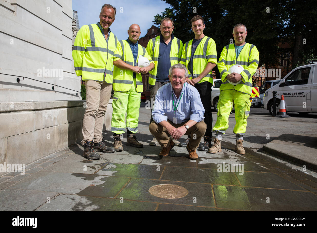 Eton, UK. 5th August, 2016. The Curator of the Eton College Natural History Museum George Fussey (crouching) poses - Stock Image
