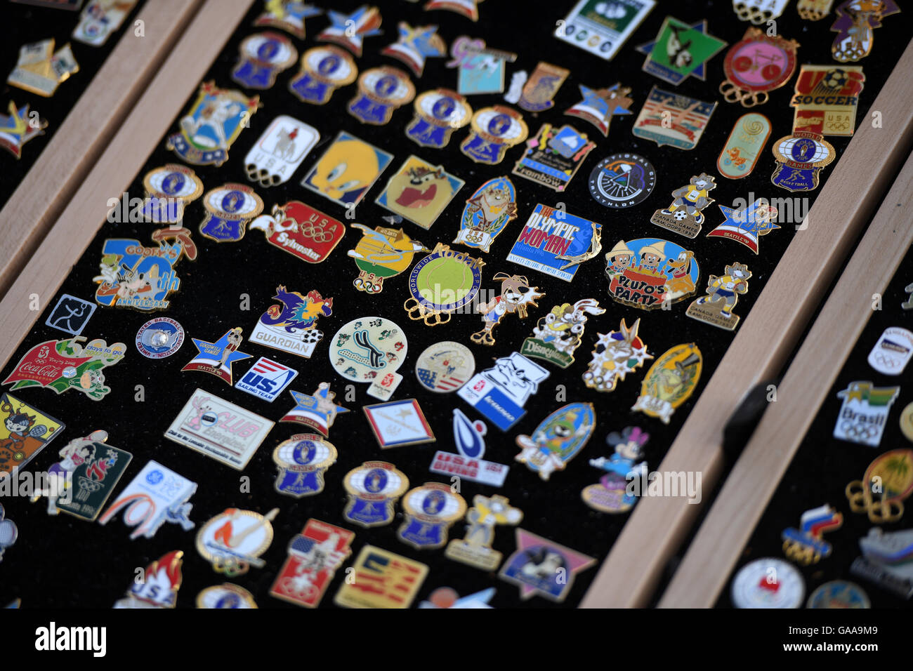 Rio de Janeiro, Brazil. 5th Aug, 2016. Historic Olympics pins are displayed on the board of a pin collector who - Stock Image