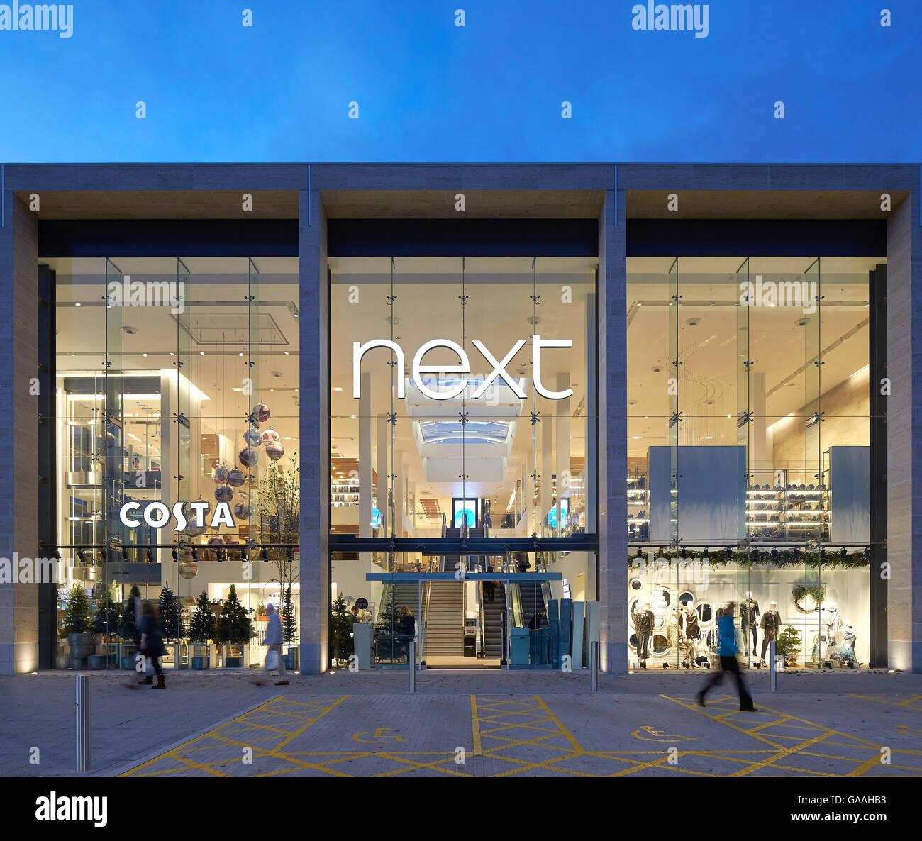 Next Home: Glazed Entrance Facade At Dusk. Next
