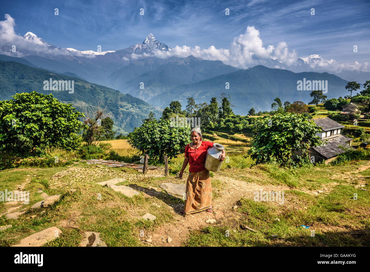 Nepalese woman in front of her home in the Himalayas mountains near Pokhara - Stock Image