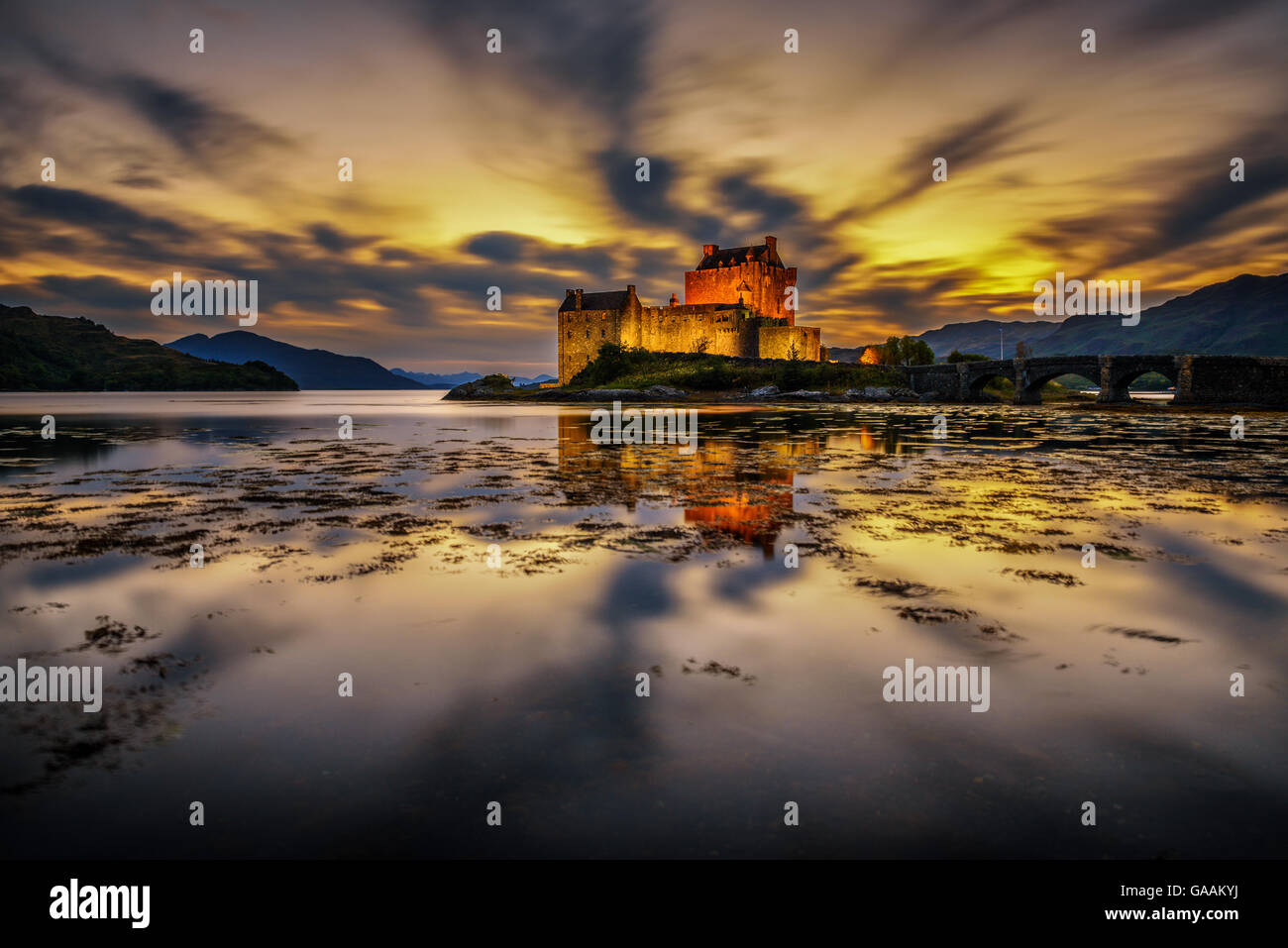 Sunset over Eilean Donan Castle, Scotland, United Kingdom. Long exposure. - Stock Image