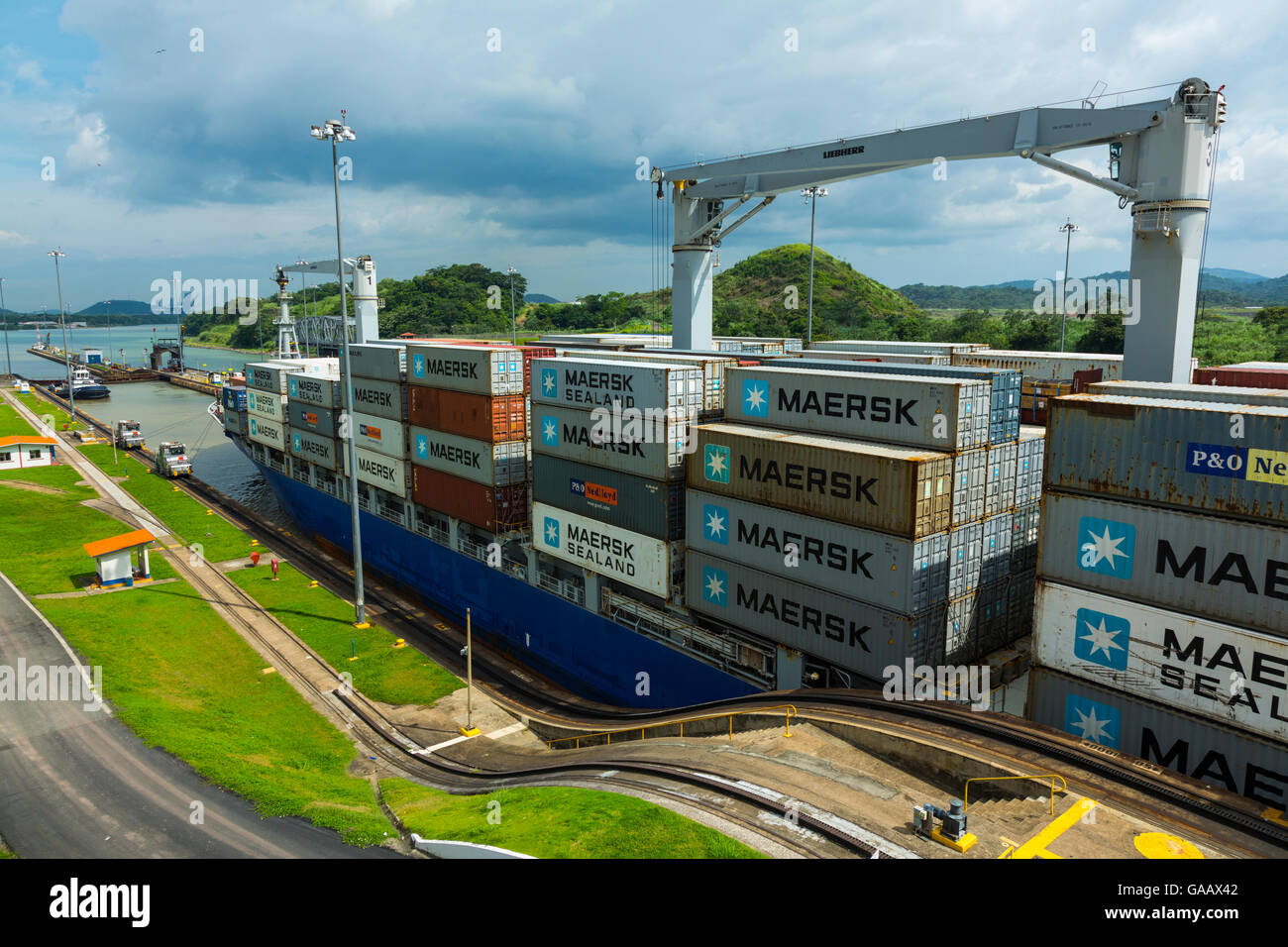 Cargo ship passing through the Panama Canal, Panama City, Panama, Central America. July 2012. All non-editorial - Stock Image