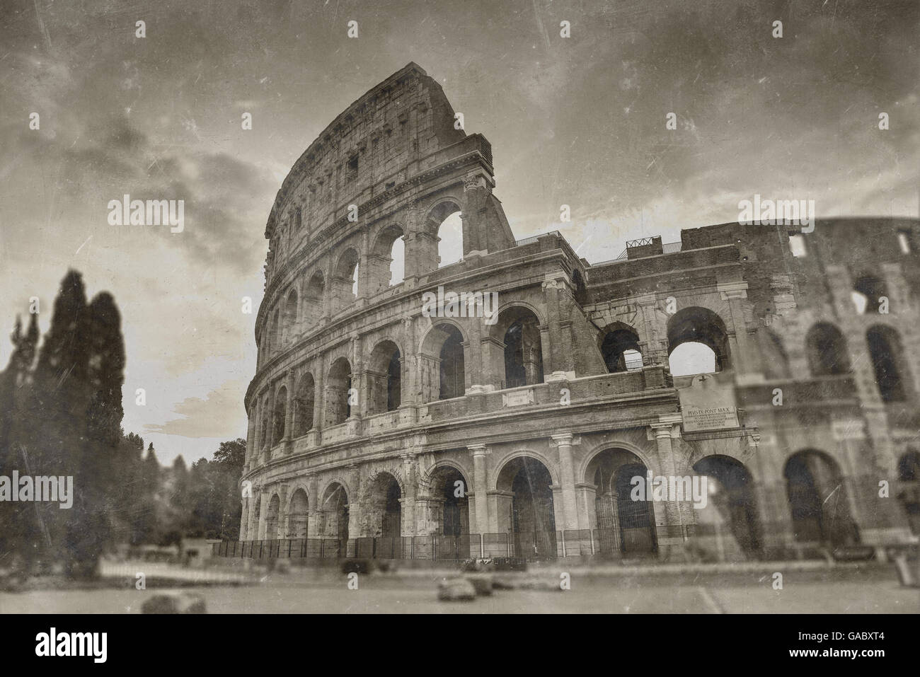 Retro tone mapped aged image of the Roman Colosseum amphitheatre in sepia tones for vintage travel and sightseeing - Stock Image