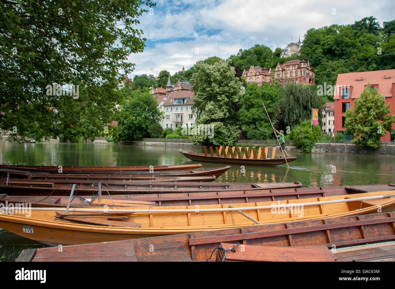 Punting on the Neckar river in Tübingen on a summer's day. Beautiful pictoresque old town in the background. - Stock Image