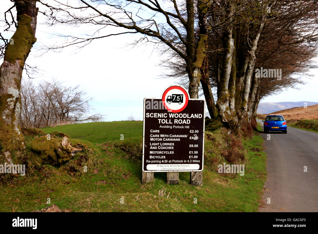 A road sign listing tolls for a scenic toll road on Exmoor. - Stock Image