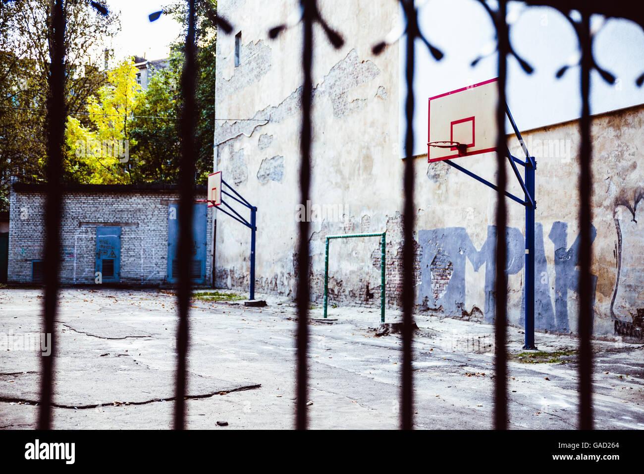 abandoned Basketball court backyard - Stock Image