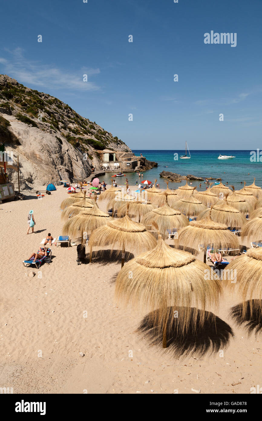 Parasols on Cala Sant Vincenc beach, north coast, Mallorca ( Majorca ), Balearic Islands, Spain, Europe - Stock Image