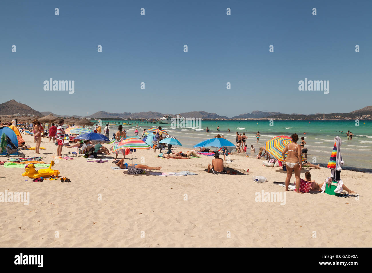 Sunbathers on platja de Muro beach, Mallorca ( Majorca ), Balearic Islands, Spain Europe - Stock Image