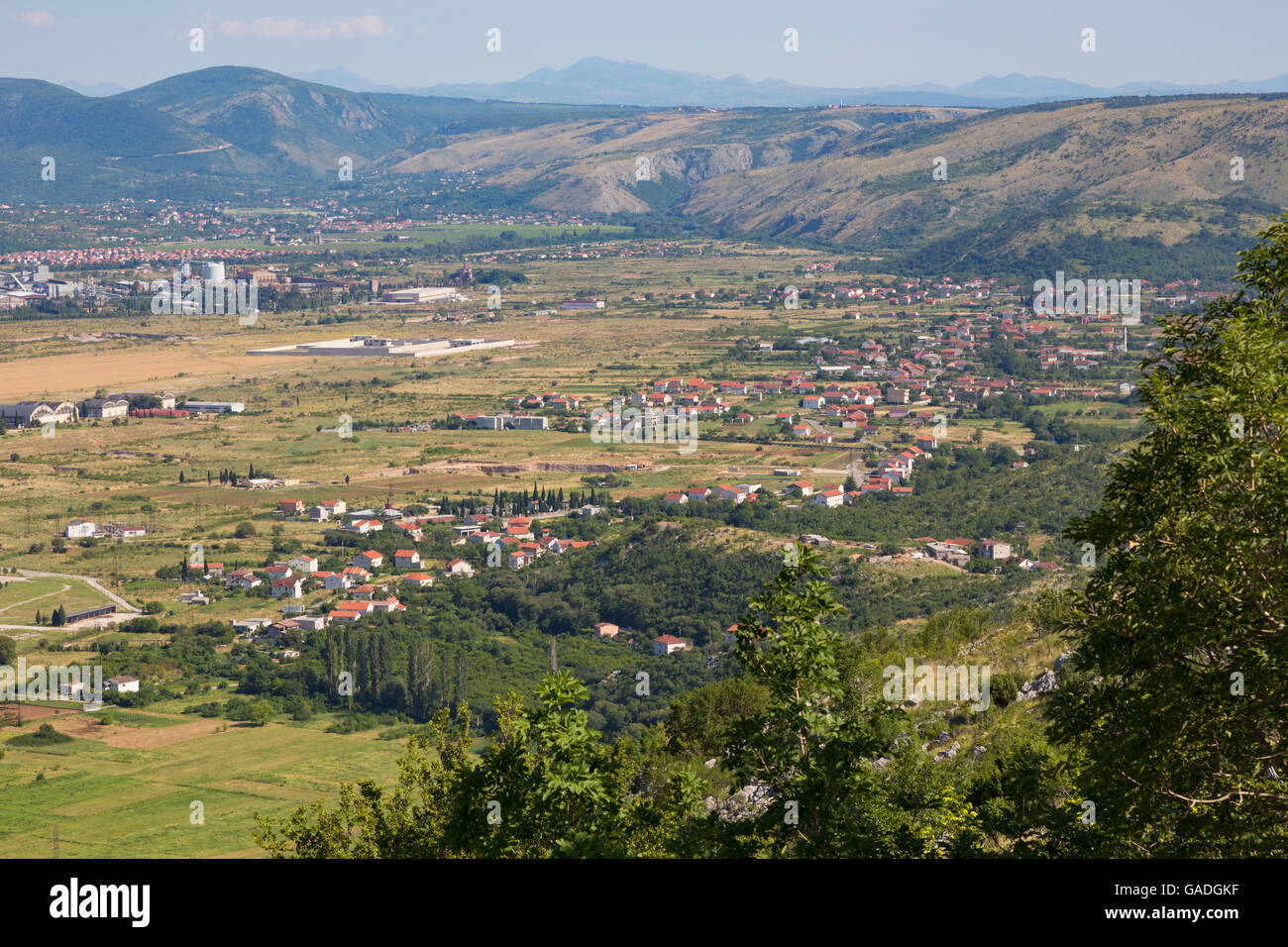 Environs of Mostar, Bosnia-Herzegovina.  Countryside with houses. - Stock Image