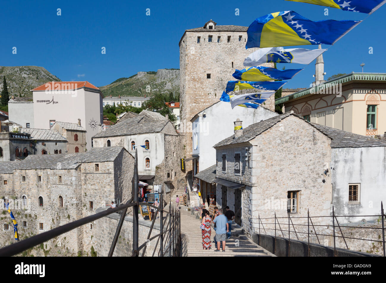 Mostar, Herzegovina-Neretva, Bosnia and Herzegovina.  Old Town seen from the single-arch Stari Most, or Old Bridge. - Stock Image