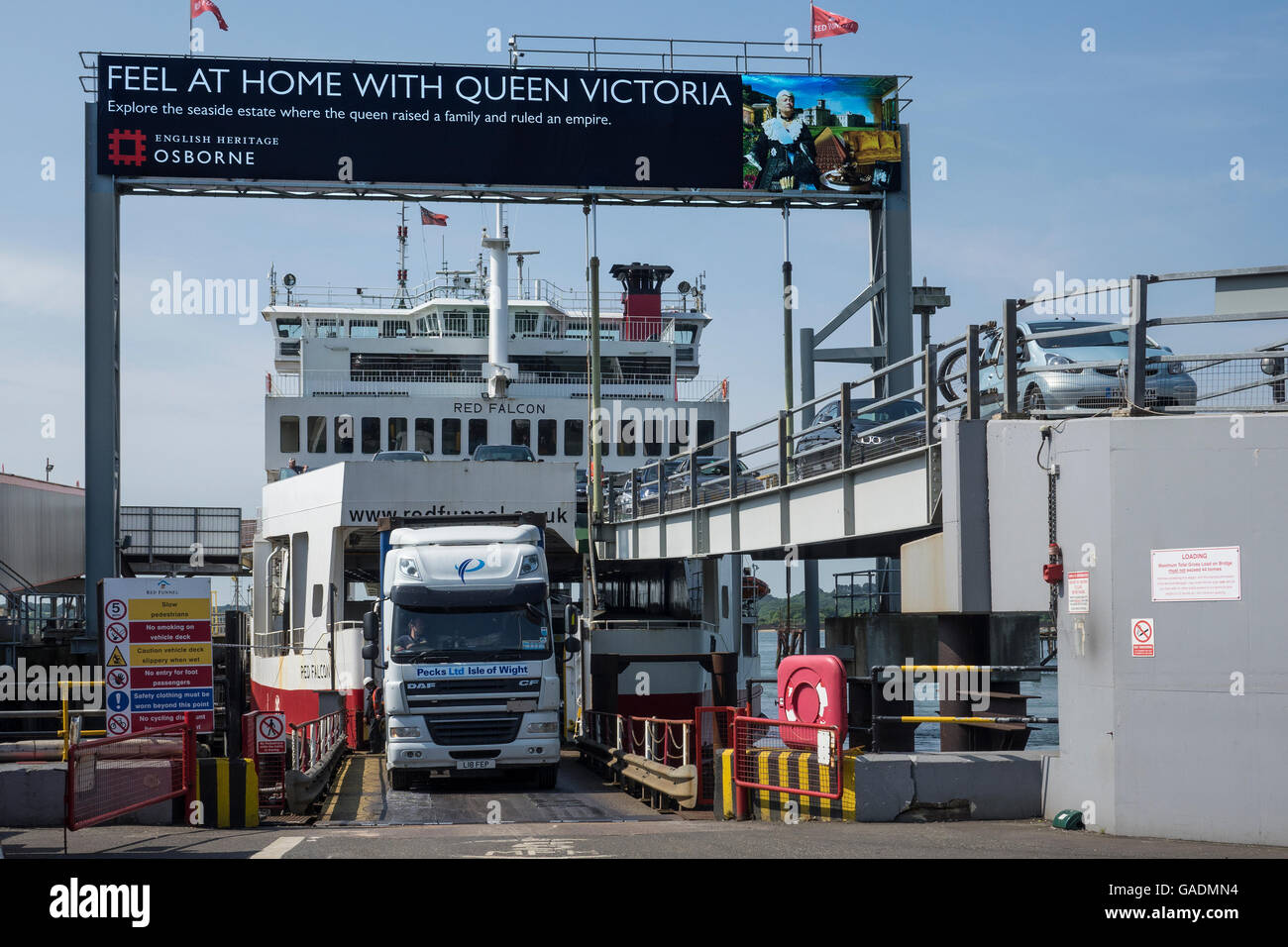 England, Hampshire, Southampton docks, Red Funnel ferry from Isle of Wight unloading vehicles - Stock Image
