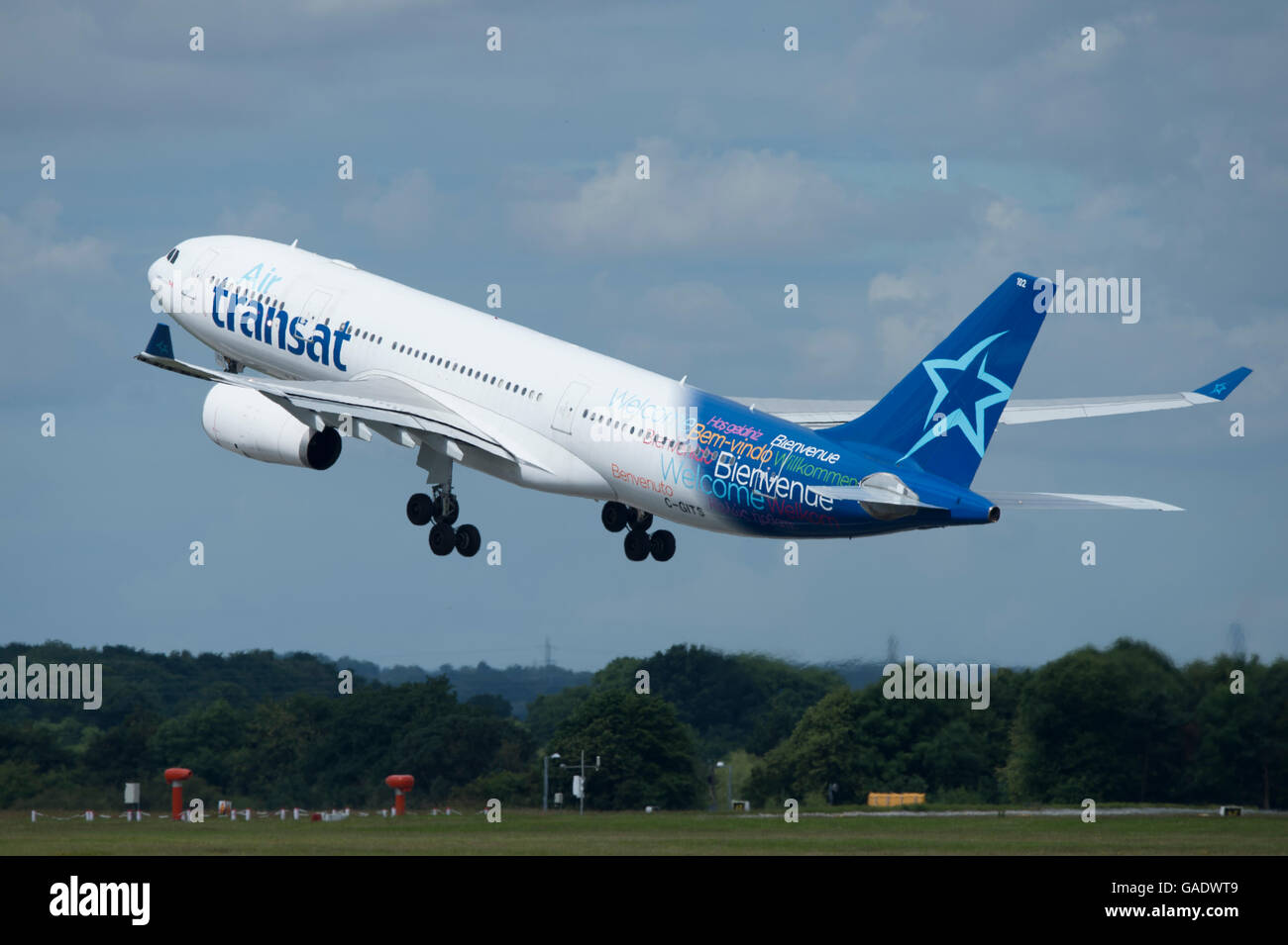 An Air Transat Airbus A330 takes off from Manchester International Airport (Editorial use only) - Stock Image
