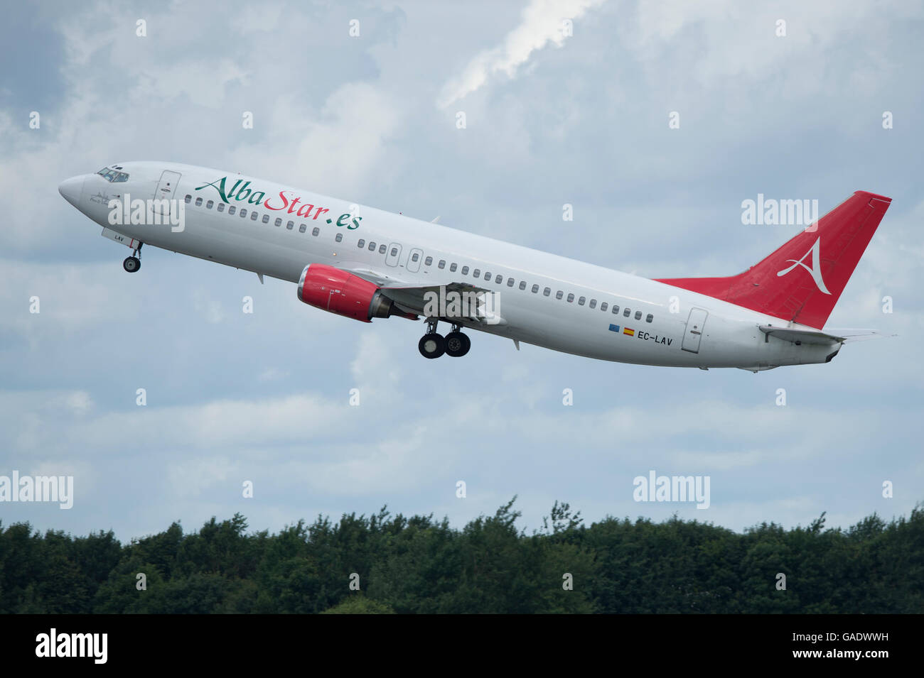 An AlbaStar Boeing 737 takes off from Manchester International Airport (Editorial use only) - Stock Image