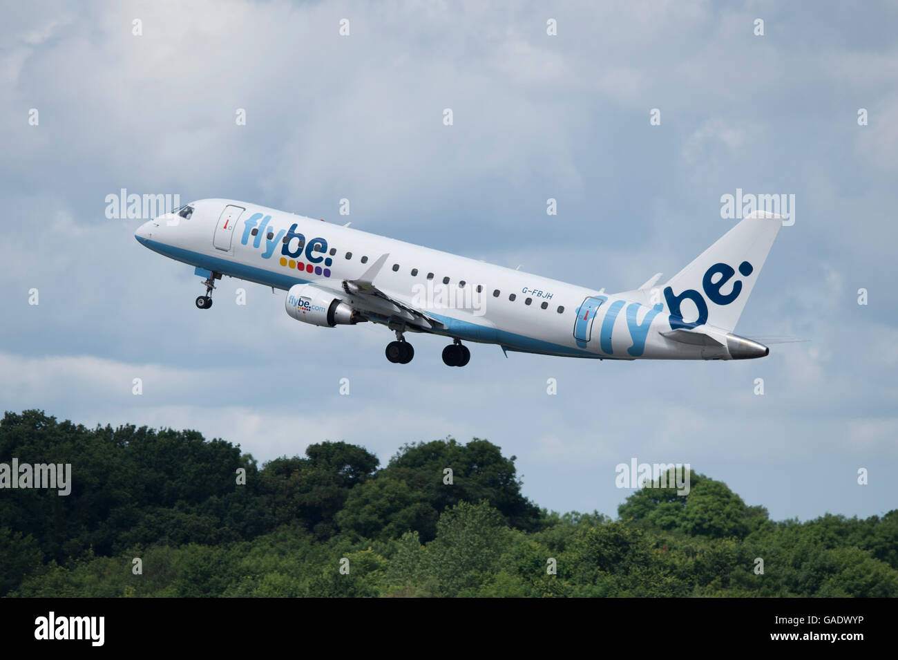 A Flybe Embraer 175 takes off from Manchester International Airport (Editorial use only) - Stock Image