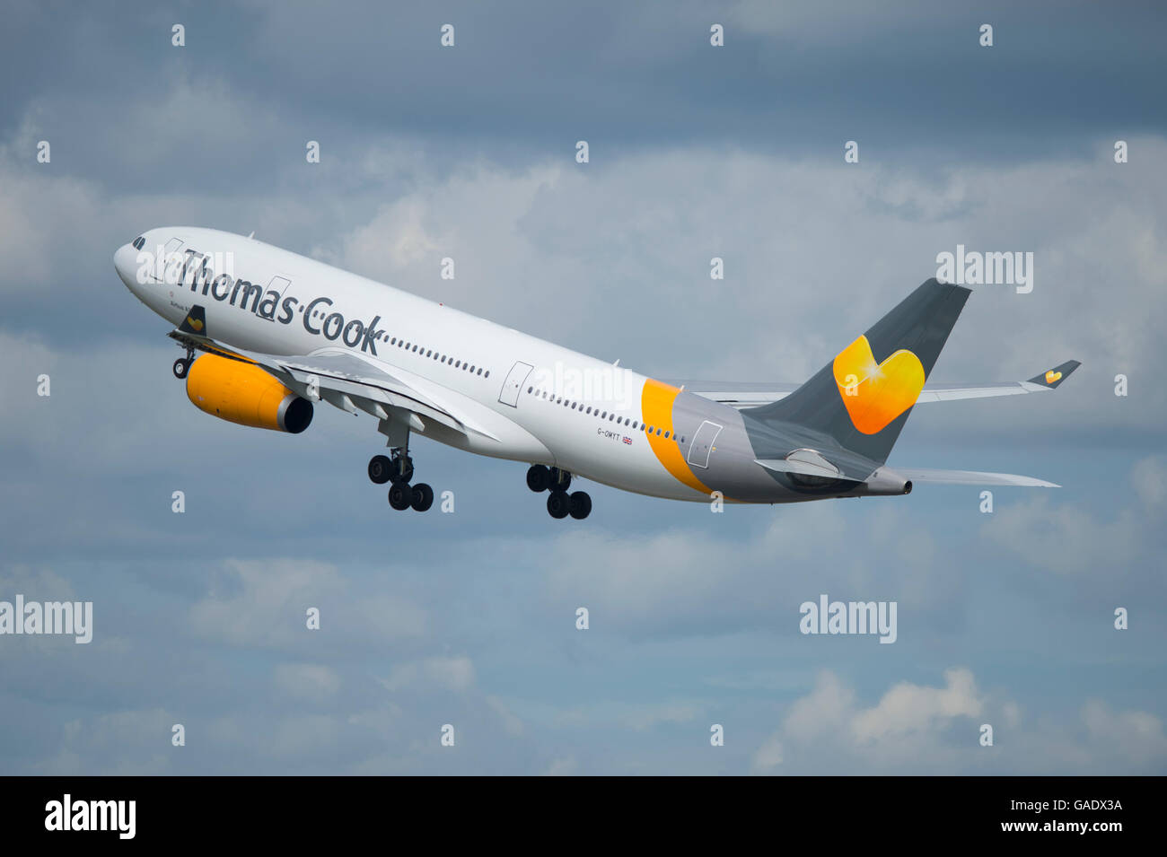 A Thomas Cook Airbus A330 takes off from Manchester International Airport (Editorial use only) - Stock Image