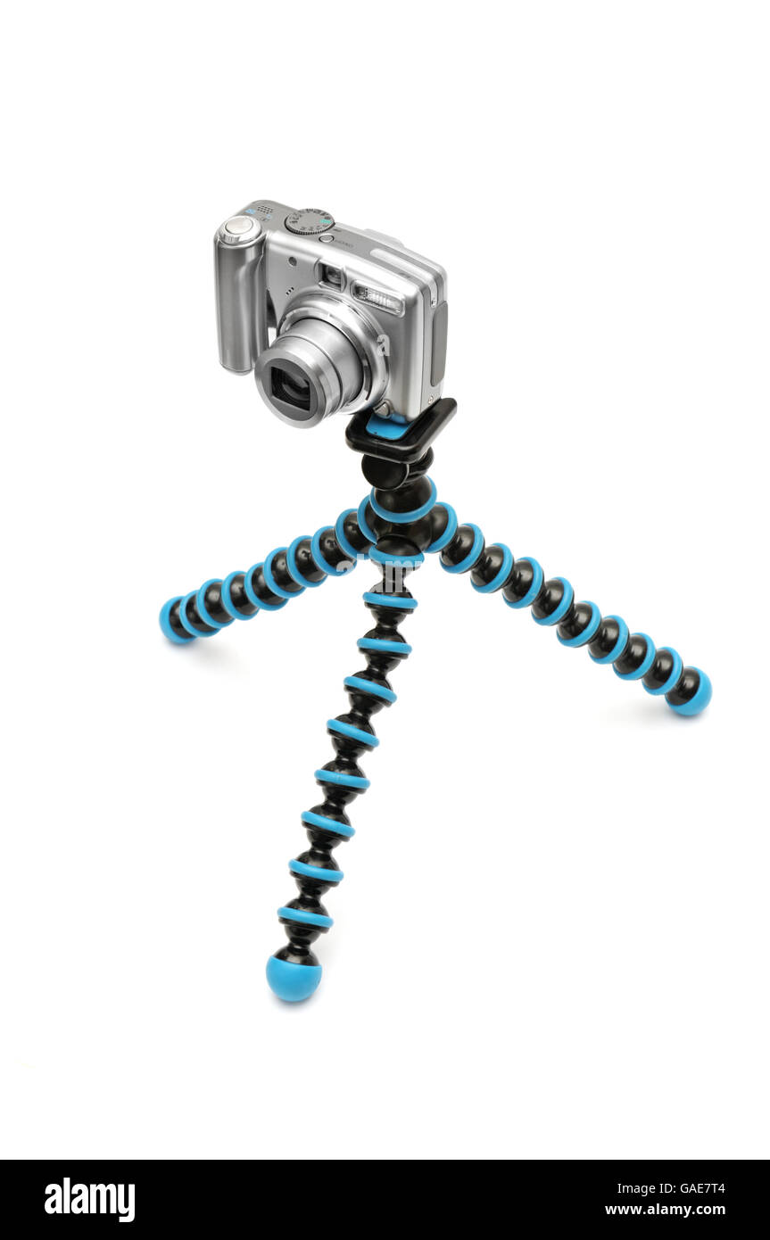 Camera on a tripod isolated on a white background. - Stock Image