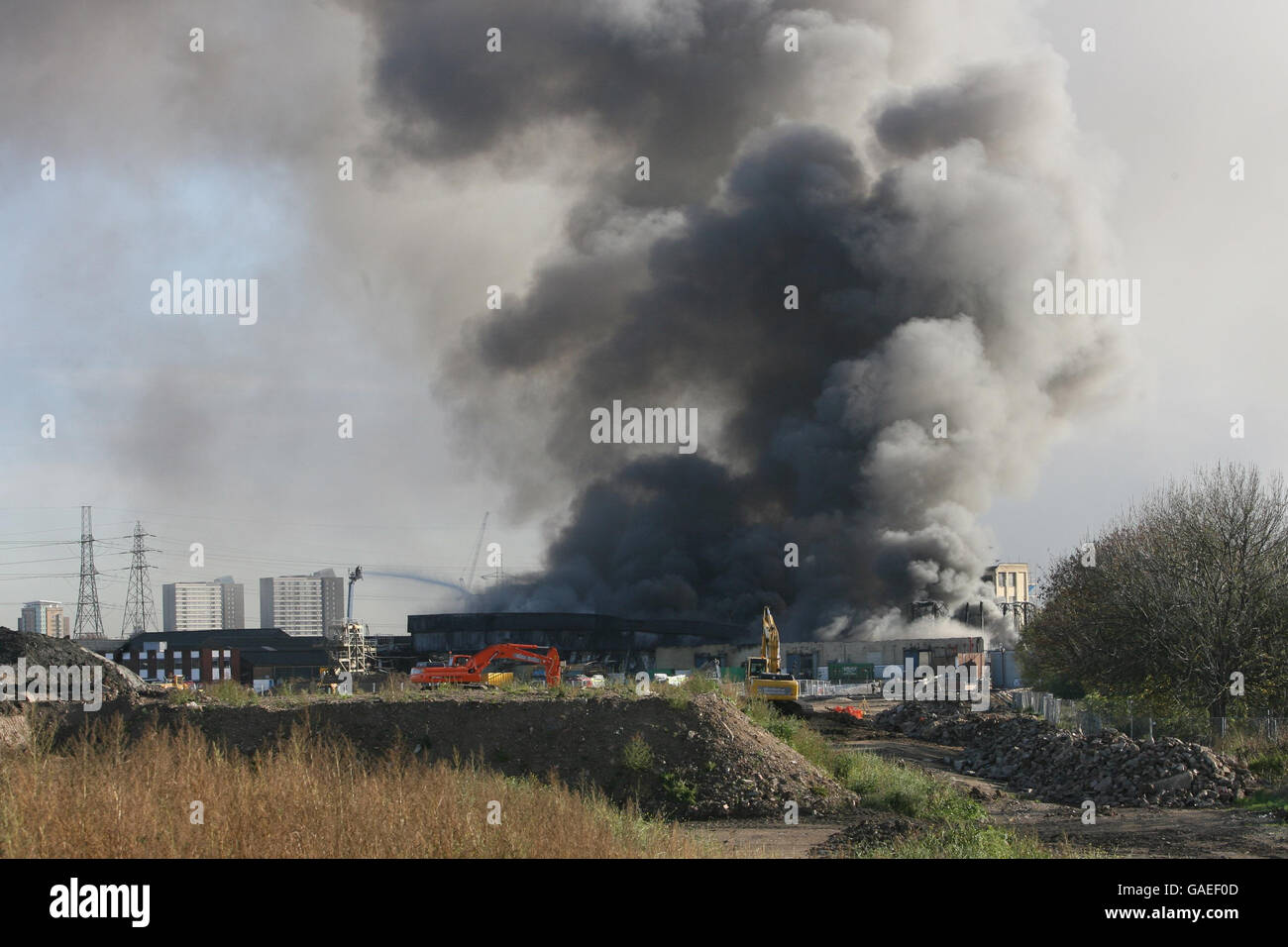 Smoke bellows from a huge fire on the 2012 Olympic site in Stratford, east London. Stock Photo