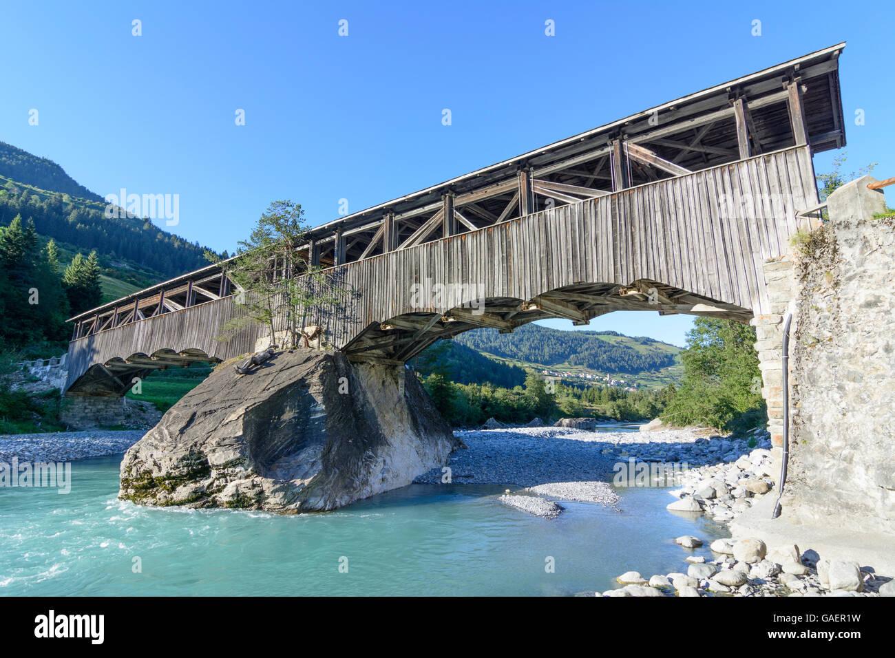 Sent Covered wooden bridge over the Inn in Sur En Switzerland Graubünden, Grisons Unterengadin, Lower Engadine - Stock Image