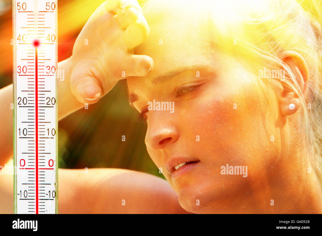 Young woman on a very hot day - Stock Image