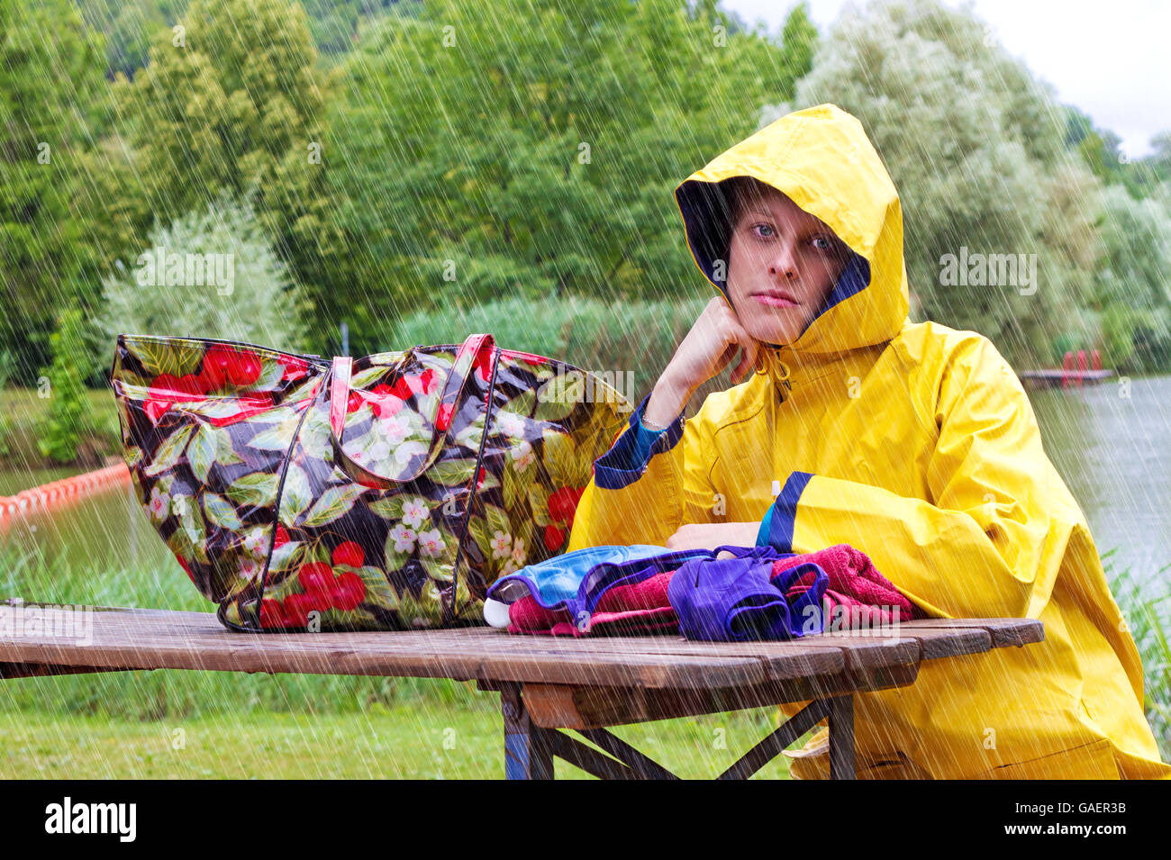 Young disappointed woman in the rain - Stock Image