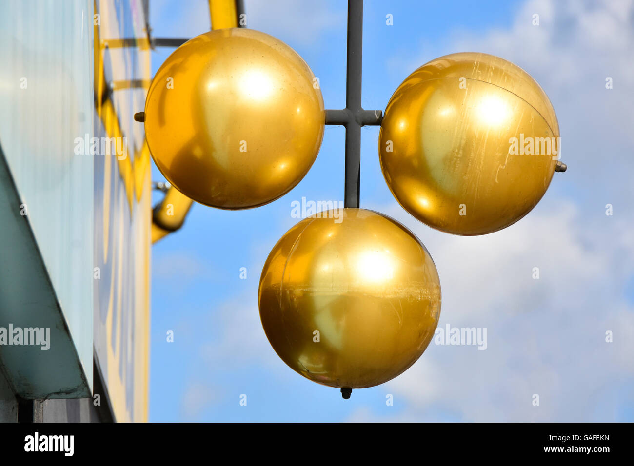 Pawn shop sign of three gold balls above Pawnbroker premises Pawn Barking East London England UK in London Borough - Stock Image