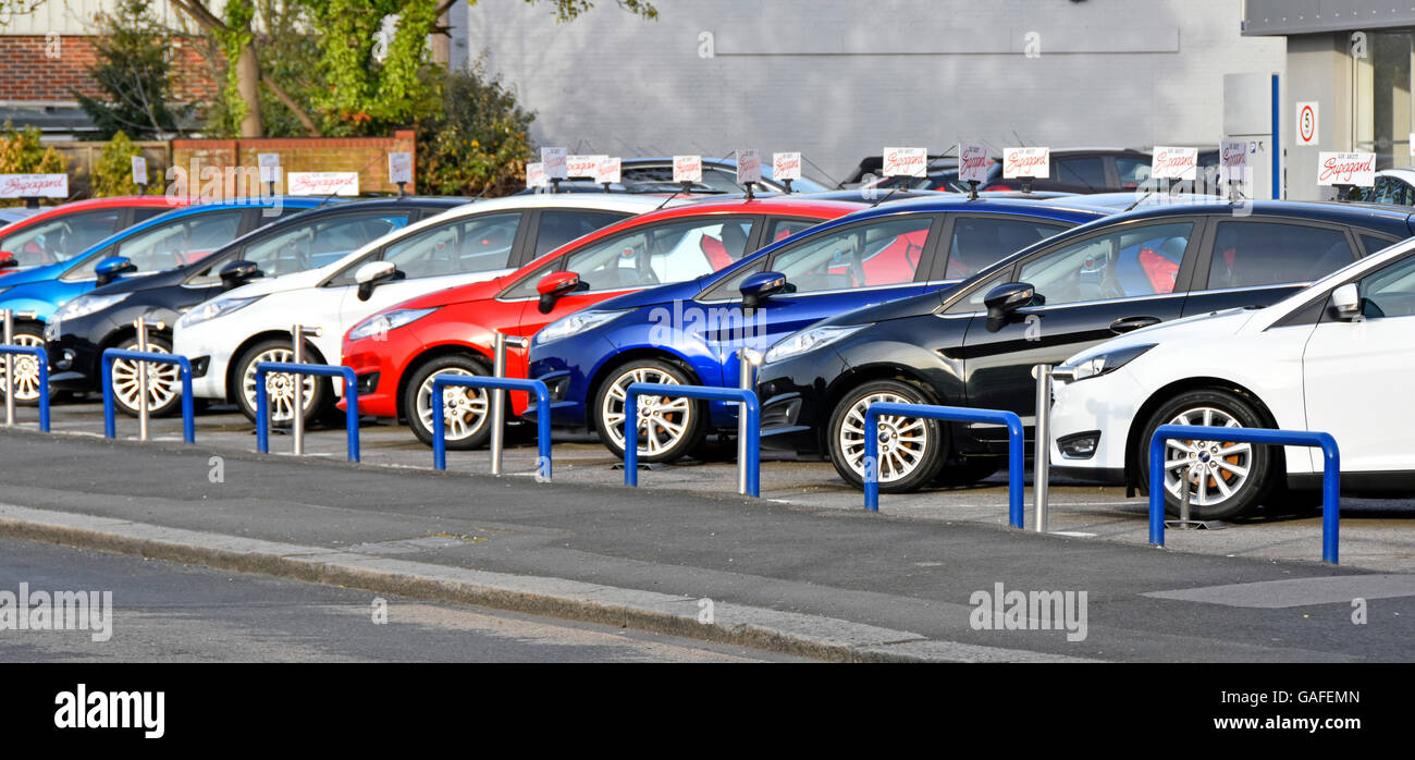 Car dealer display of used cars for sale on main Ford dealership ...