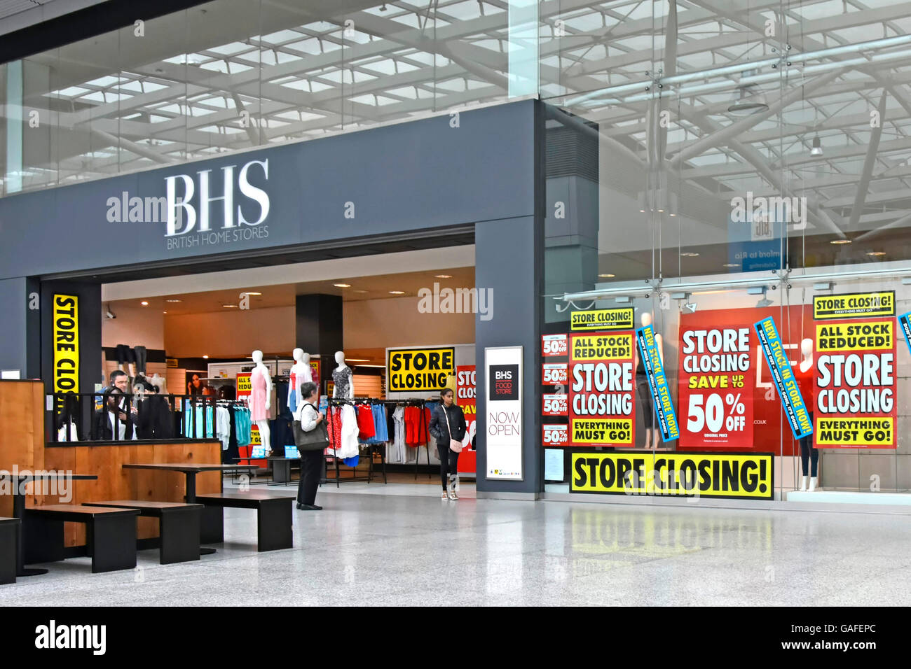 England UK BHS store shop front in indoor shopping mall holding closing down sale prior to all UK British Home Stores - Stock Image